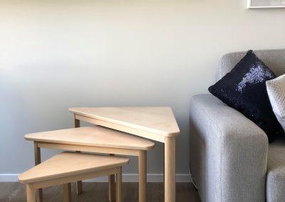 Side tables alongside sofa
